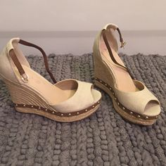 Aldo beige linen peep toe wedge w/ gold studs Aldo beige linen platform wedge with gold studs and brown leather ankle strap. Shoes have never been worn. Heel is approx 4 inches ALDO Shoes Wedges