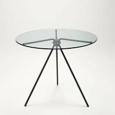 Prima Table by Alvaro Catalàn de Ocòn. The Prima Table arose from the idea of creating a demountable table in which all the legs are identical and assembled without welding. The result is an object with a highly elegant form and design. The central joint in aluminium alloy enables the legs to be mounted and demounted with a straightforward movement using a single screw. Three simple rubber rings stop the crystal top from sliding on the metal structure.