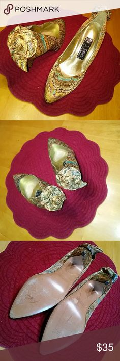 J. RENEE COUTURE COLLECTION 👠 HEELS! SIMPLY BEAUTIFUL AND ELEGANT HEELS! FEATURES A GOLDTONE PEACOCK PATTERN WITH A FLOWER BOW AT BACK OF SHOE! SO DETAILED AND PRETTY! GREAT CONDITION. SO UNIQUE! THEY COMPLIMENT SO MANY DIFFERENT OUTFITS. J. RENEE Shoes Heels