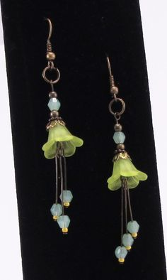 "Delightful! I just love how lightweight and dangly these earrings are, they are just too cute not to show off with an ""updo"" hair style. They are made with antique style bronze metals, lucite flowers and pretty frosty green Czech crystal bicone beads.  $18.00"