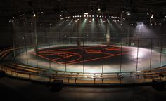 Mens A/W 2014 / Givenchy: To set up Riccardo Tisci's Bauhaus and basketball-inspired collection for GIvenchy, the designer began the sporting proceedings by drawing a neon basketball court on the Halle Freyssinet's concrete floor. Wooden benches were arranged around a circular schoolyard fence to enclose the high-octane setting
