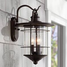 From the Franklin Iron Works™ Casa Mirada collection comes this warm and rustic style outdoor wall light. The light features a bronze finish with seedy glass for a traditional look. The classic style will add charm to your home. Outdoor Wall Lighting, Outdoor Walls, Home Lighting, Lighting Ideas, Entry Lighting, Cottage Lighting, Pergola Lighting, Outdoor Sconces, Farmhouse Lighting