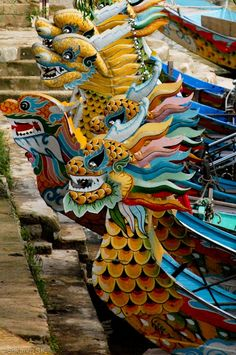 Colorful dragon boats ~ human-powered watercrafts. Traditionally handcrafted in the Pearl River delta region of southern China - Guangdong Province