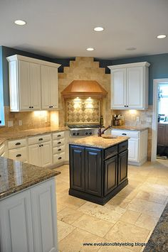 Might have already pinned this??? But, I really want to paint my island black and the other cabinets a red rust color!