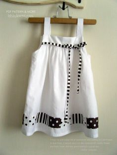 Baby Dress with buttons on the straps to adjust length...could be made so that the shoulder straps tie
