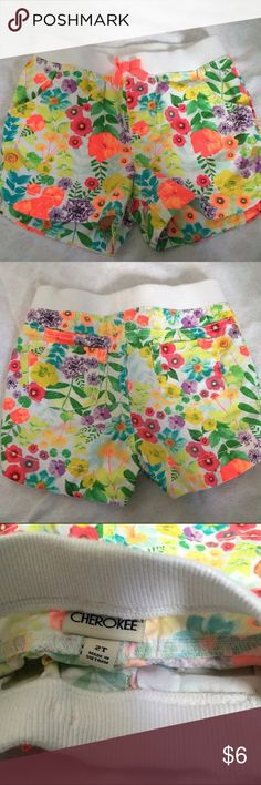 """💖EUC 2T Cherokee Shorts - Vibrant Flowers 💕EUC - Beautiful & Vibrant 2T Cherokee Shorts. Perfect Vibe for Spring & Summer  🔸No holes, rips or stains 🔸Truly beautiful w/ vibrant, colorful flowers throughout  🔸Elastic waist measures aprox 9""""  🔸100% cotton w/ 2 pockets at the back 🔷 Don't forget to Bundle! Save 20% off 2 or more items. Please feel free to ask any questions Cherokee Bottoms Shorts"""