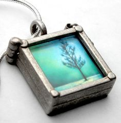 Not only is this a beautiful little chunky pendant with a great photo, it is reversible (there's another photo) AND it comes with 20 photos! That's an awesome idea and a good deal. Tip of the hat to @isel_  for the pointer to the Etsy store.
