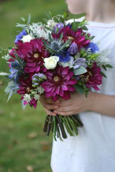 Wedding bouquet in burgundy, blue, lilac and white including dahlia, thistles, cornflower and freesia. www.libertyblooms.co.uk