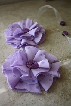 Another fabric flower (folds with a button in the middle)