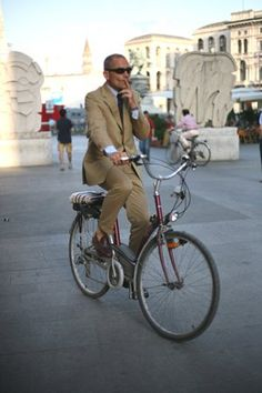 The classic - Bike and smoke - I Bike because it's a bitch to park in Milano and I smoke because it's what I've done since 15yrs old.. The suit and no sock loafers are just right.