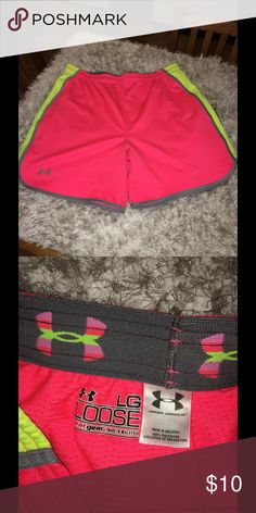 Under Armour Loose Fit Shorts Ladies Large Under Armour athletic shorts.  Inside drawstring waist.  Loose fit.  Pink with yellow and grey accents.  Size large.  Good condition. Important:   All items are freshly laundered as applicable prior to shipping (new items and shoes excluded).  Not all my items are from pet/smoke free homes.  Price is reduced to reflect this!   Thank you for looking! Under Armour Shorts