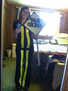 Easy Halloween Costume for Pregnant Ladies! All you need is black clothes, yellow duck tape, scrapbook paper, and a yard stick!  So easy, and adorable. Very clever!