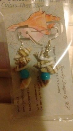 Check out this item in my Etsy shop https://www.etsy.com/listing/278541666/seashell-earrings-with-light-blue-beads