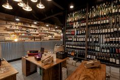 Epífita Arquitectura, together with AB Estudio, have designed a wine shop for La Parra Winery, in Buenos Aires, Argentina. The facade of the wine bar has been made of OSB, and is designed to look like a box of wine. from contemporist