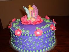 Tinker Bell Cake - round 2-layer - mainly purple with green accent icing and pink flowers