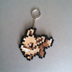 Pokemon: Perler Bead Eevee Keychain by Frost's Art & Design. A portion of every purchase is donated to cancer research.