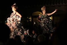 These two models sport dresses made of reused paper. The designs debuted at an Earth Day fashion show in Temecula.