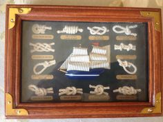 "Nautical shadow box display featuring a Sailing Ship and 12 nautical rope knots 6 3/4"" X 5"""