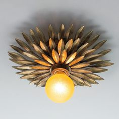 """Olive Leaf Dual Mount Ceiling LightWrought iron like olive leaves form a sunburst ceiling light in hand-painted antique gold. Mount as a ceiling light or wall sconce. Perfect for a powder room or long corridor. The classic shape lends itself to an array of interior styles. Create an interesting pattern on the walls or ceiling with this versatile fixture.  100 watt medium base lamp required. (11""""diameter x 3.5""""D)"""