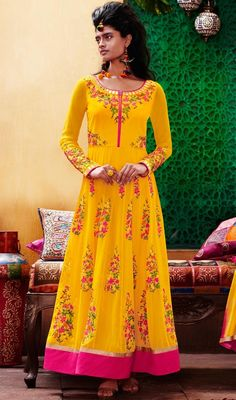 Trendy and stylish, this Anarkali suit in yellow color georgette and raw silk. You are able to see some fascinating patterns done with lace, mirror and resham work. #YellowFloralWorkGeorgetteRawSilkAnarkali