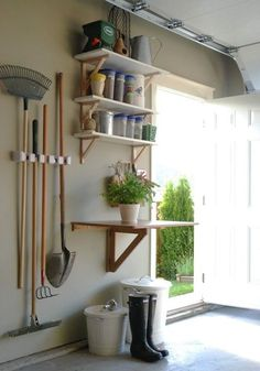 28 Brilliant Garage Organization Ideas | Make a separate garden station in the garage! I love the fold down table idea.