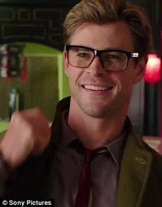 She likes what she sees: Kristen Wiig can be seen swooning over Chris Hemsworth in the new...