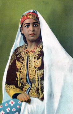 Africa | Woman wearing costume from the interior.  Algeria || Scanned vintage postcard