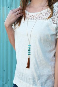 "Nothing goes together better than turquoise and chestnut! The Cobble Crest Necklace features a chestnut tassel and turquoise descending stones on a long gold chain. - Chain length is 31"" - Does not ha"