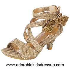 The newest look in girls fashion high  heel shoes. Textured fabric with shiny thread woven into it, rhinestone embellished  bow, crisscross ankle straps, and a zipper back complete this lovely shoe in toddler and children s sizes (9-4). This style is also available in fuchsia pink and white.