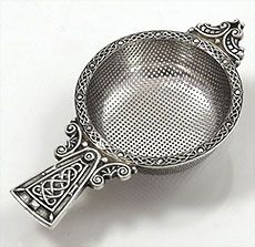 A E Jones English silver tea strainer . Arts and Crafts styling w/ very finely pierced bowl, chased handle in Celtic knot pattern, sterling silver, Birmingham, UK Tea Strainer, Tea Infuser, Vintage Cutlery, Buy Tea, Tea Tins, Tea Caddy, Tea Art, Coffee Set, Tea Accessories