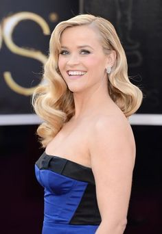 Reese brings Old Hollywood glamour to the red carpet with that gorgeous hair. #Oscars #beauty