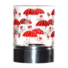 Moomin candleholders are multifunctional design pieces that can bring joy to any home. This one has Little My hanging on to her red umbrellas on it.