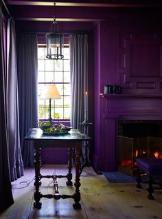 Purple done really well. It makes the room feel both modern and classic. And I love the dark wood alongside. Such a cozy room.  ---  photos by Eric Piasecki