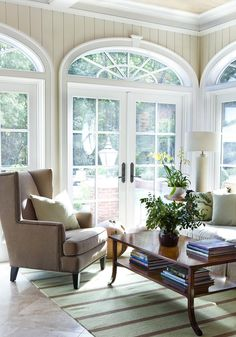 Classic living room with traditional furnishings and gorgeous arched windows.