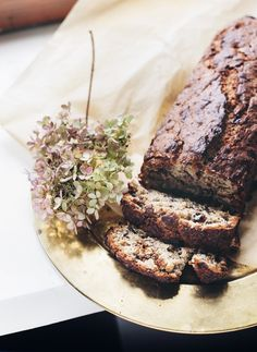 Banana bread with dark chocolate, candied ginger and hazelnuts.