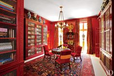 In a Houston home, decorator Miles Redd lacquered the library's paneling and installed a chandelier by Robert Kime over a George II drum table found at Sotheby's and George III–style chairs purchased at Christie's.