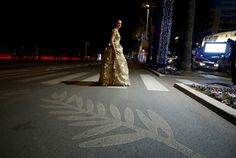 A woman walks on the Croisette during the 69th Cannes Film Festival in Cannes, France, May 17, 2016.   Photographing the Cannes Film Festival comes with highs and lows: from the long hours and painstaking task of setting up equipment to the thrill of getting the perfect shot. Reuters photographers have not only worked to capture auteurs talking about their films and stars posing on the red carpet. They have also shot a set of pictures showing their own quirky view from behind the scenes as…