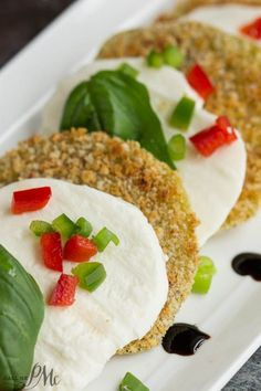 Fried green tomatoes are crispy and golden and fantastic by themselves, but layer with mozzarella and basil and it's salad perfection. Oven Fried Green Tomato Caprese Recipe with Balsamic Reduction