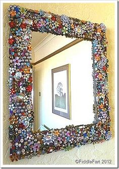 From recycle.co.uk this beautiful mirror frame is made from upcycled unwanted jewellery and scrap, is it possible to scratch on passing though? Ensuring that all sharp edges are smoothed is essential but its a great idea!