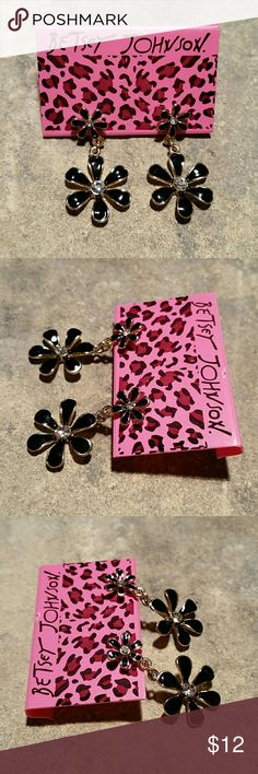 """Betsey Johnson Black Daisy Dangle Retro Earrings New, never worn, with holding card tag, retro vintage style black enamel and shiny gold metal Betsey Johnson dangle earrings. Two starburst daisy flowers with crystal rhinestone centers, post studs with supportive clear shield bullet backs. Measure 1.5"""" long, .75"""" wide.  Thank you for visiting my closet, and happy poshing!! :)  SORRY, NO TRADES  BUNDLE & SAVE! Betsey Johnson Jewelry Earrings"""