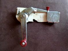 A wall mounted can opener.