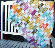Modified coin quilt, using 5 inch charm packs.  Cut a 5 inch square in half, then sew a 2.5 inch white square to one end of each coin. Sew into columns with the white square alternating sides