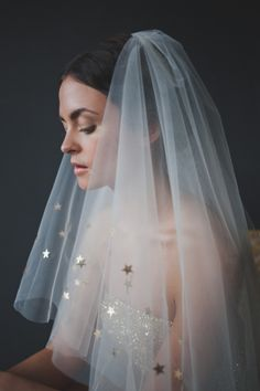 Not LED Wedding Decor this time, but would match nicely: love the shiny metallic stars on this veil!