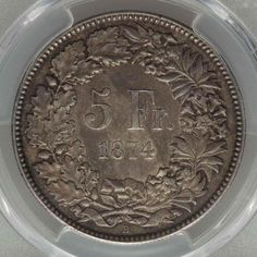 Description: A nice looking About Uncirculated PCGS AU50 crown size silver coin from Switzerland. This is the 1874 five francs Confederation silver coin. The co