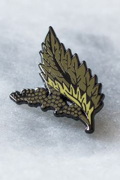 """From our series of 4 lapel pins based on common weeds - unwanted little guys. Nettles are used in food, drink, medicine and textiles. 1"""" hard enamel pin."""