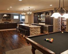 Dark stained Hickory flooring in this Man Cave....