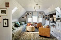 The top-floor media room is intentionally reminiscent of a ship, from its nautical beadboard walls and ceiling to the custom media cabinet's hidden bunks. The Verellen sofa—upholstered with Boa, a textile by Nomi Fabrics—was custom-made with bench cushions sized to match twin mattresses.