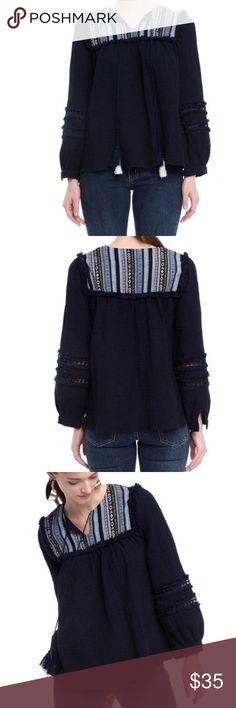 Navy blue blouse Navy straight blouse, slit neckline with hanging string tassels, crochet detailing in balloon long sleeve and light blue tribal print at yoke. True to size. Style Mafia Tops Blouses