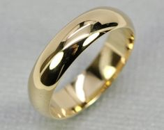 14K Yellow Gold Mens Wedding Band Half Round Classic Shape 5 x 1.5mm, sizes 6-8 this listing, Sea Babe Jewelry  RING SIZE: This listing is priced for sizes 6-8 US. Larger/smaller sizes available. MATERIAL: Solid 14K Yellow Gold DIMENSIONS: 5mm wide by 1.5mm thick approx. SHAPE: half round TEXTURE/FINISH: smooth/polished   *If you do not see your ring size listed, or you would like this item customized, please use the Request Custom Order link above.  sizes 8.25-10: https:/...