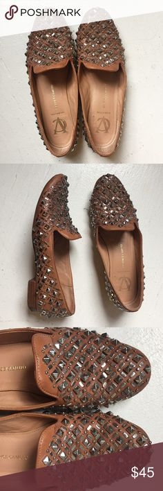 ✨Vince Camuto Signature ✨Rock Stud Loafer Vince Camuto Signature rock stud loafers are so adorable/ they are samples but they are the shoes that go with everything and always get compliments on. They are worn but don't show it once they are on. Comfortable and a perfect pop of shine Vince Camuto Shoes Flats & Loafers